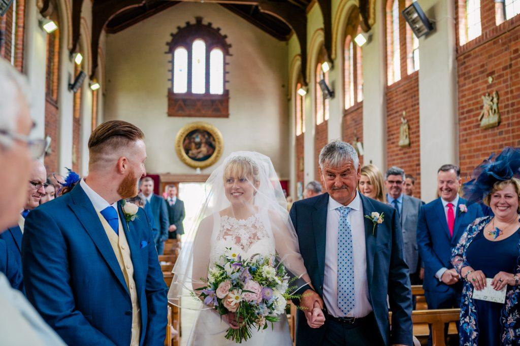 Bride and groom meeting.