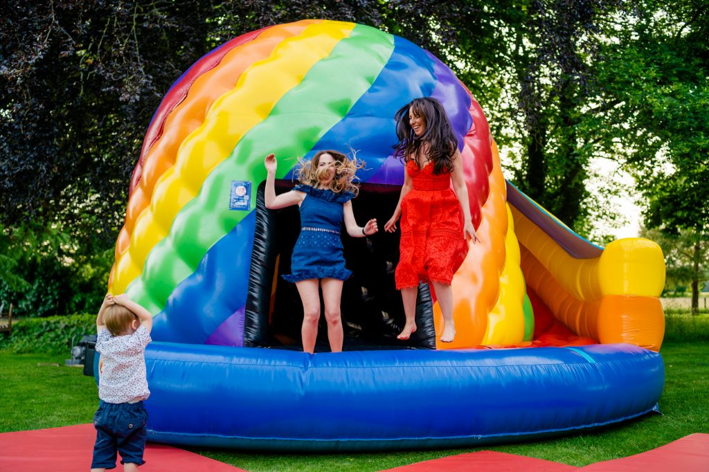 Wedding guests on bouncy castle