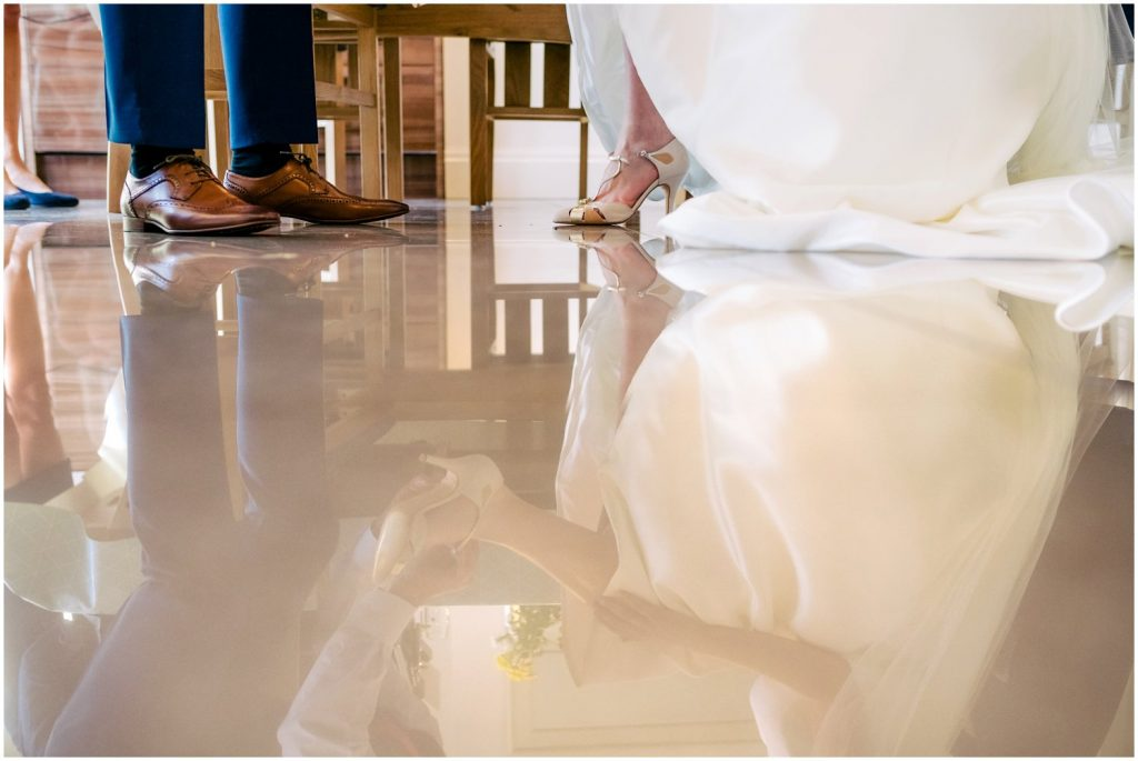reflection of wedding shoes