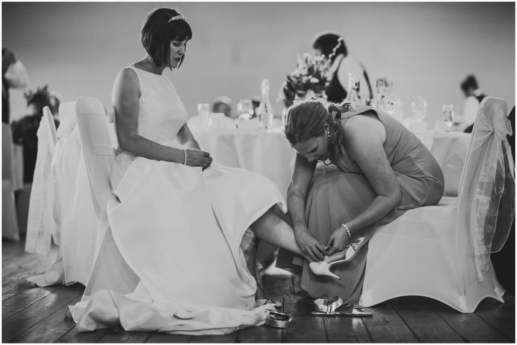 Bride changing wedding shoes