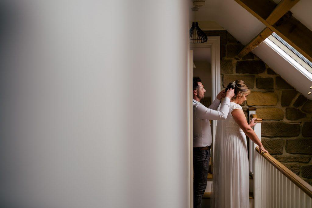 Bride getting dress tweaked