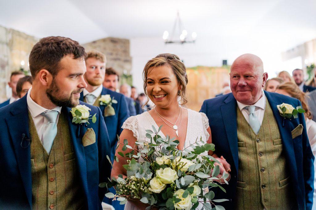 Smiling bride at Danby Castle Wedding