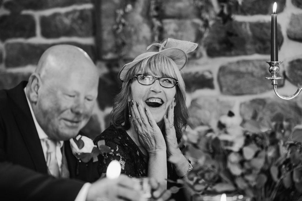 Brides mum laughing during wedding speeches