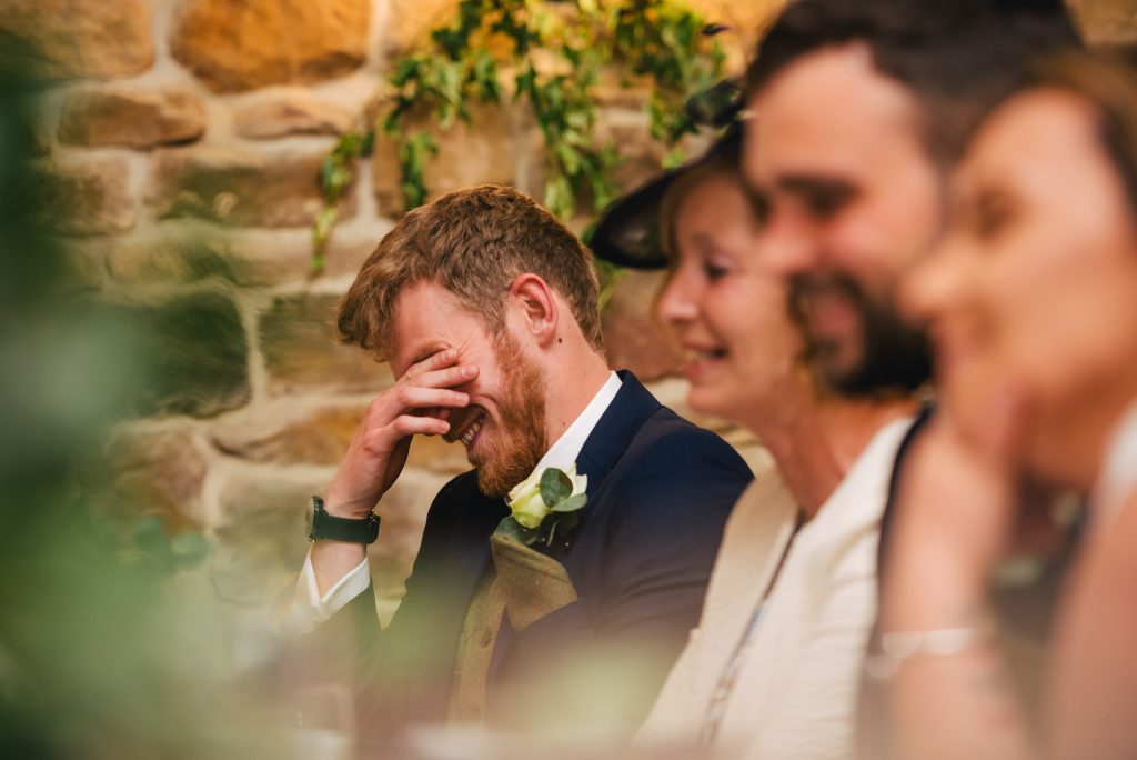 embarrased brother during wedding speeches