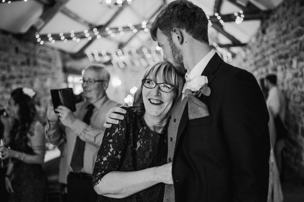 mum and son at wedding