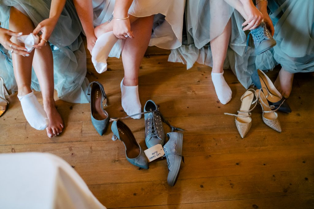 Bride and bridesmaids changing shoes