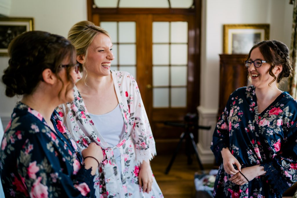 Bride laughing at Denton Hall