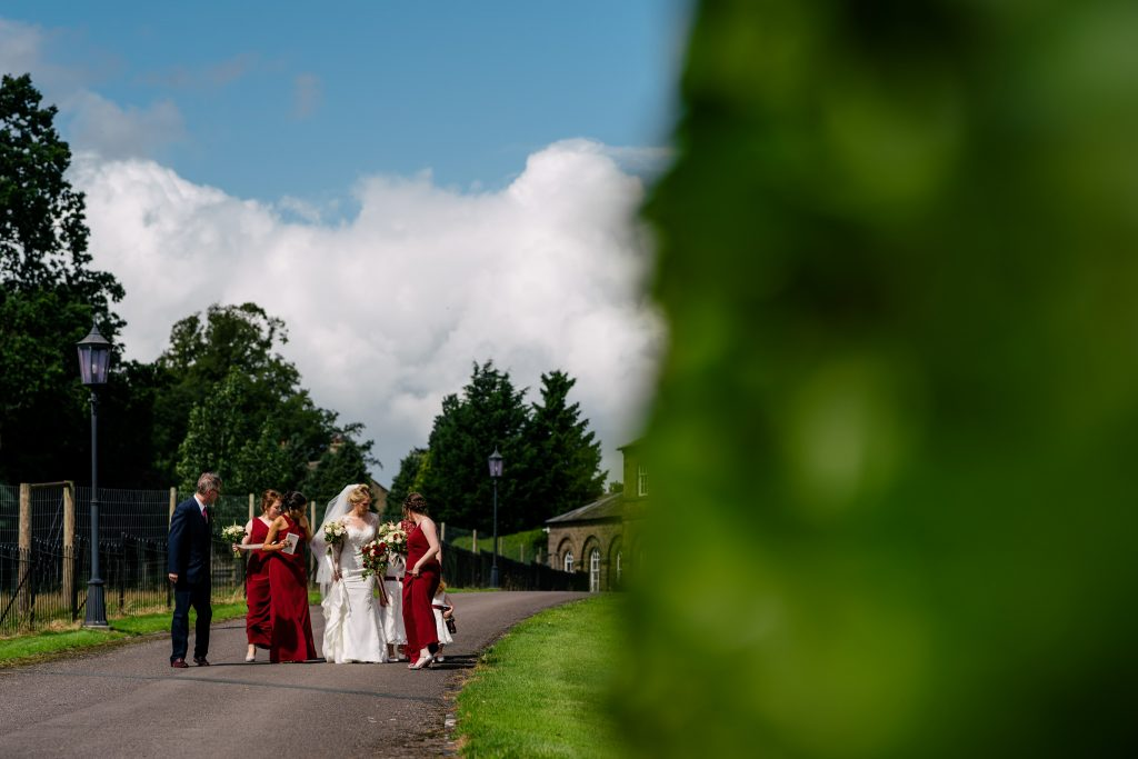 Bride walking to Denton Hall ceremony