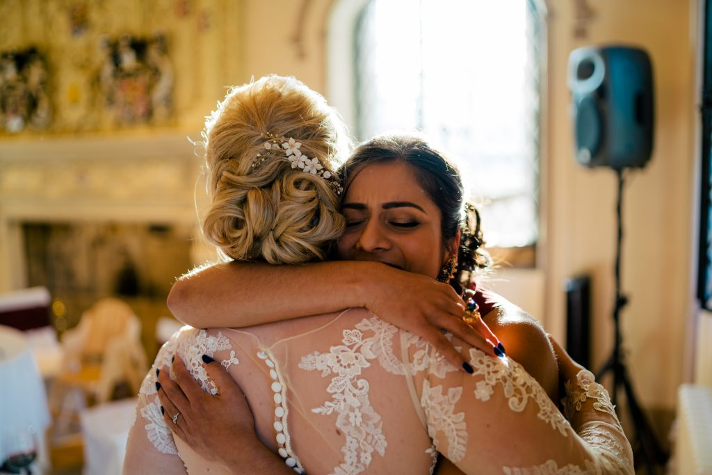 Wedding hugs at Denton Hall
