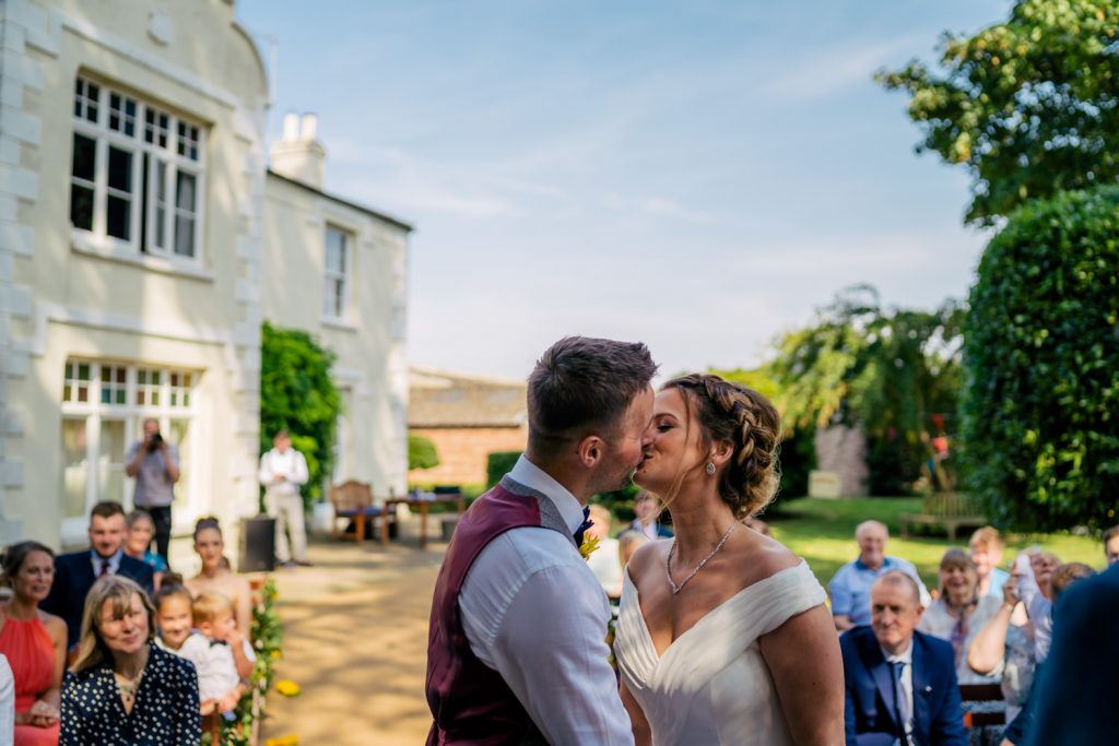 first kiss at backyard wedding