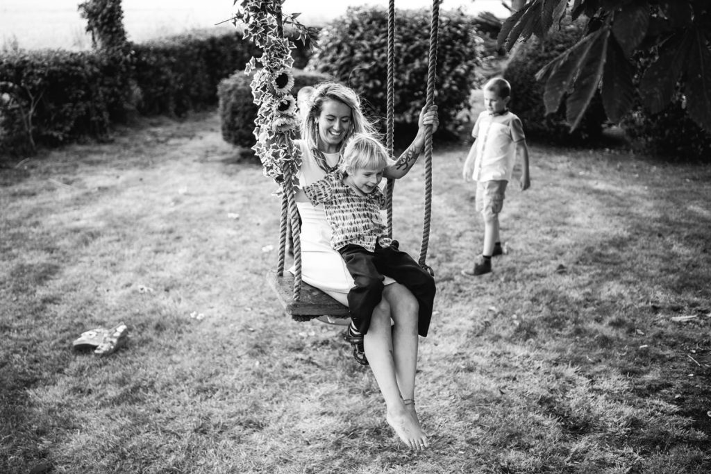 Wedding guests on swing