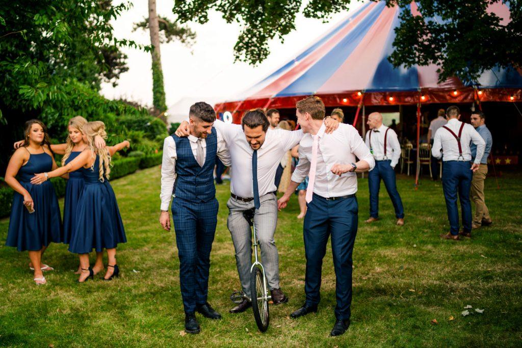 wedding guests on unicycle
